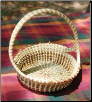 ROUND CROSSHANDLE SWEETGRASS BASKET W/ LOVE KNOTS